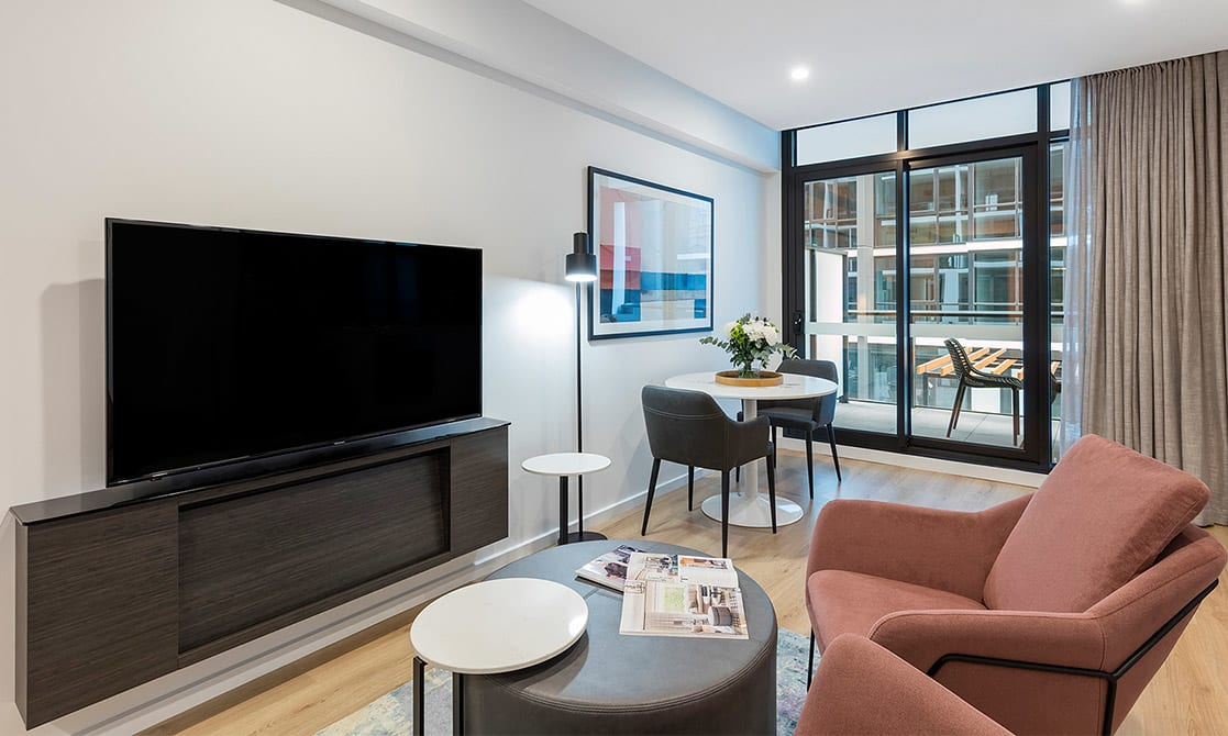 Living Room Equipped with TV and Study Table and home comforts  at Avani Adelaide