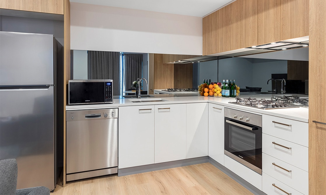 Fully equipped modern kitchen with Fridge, cook-top, oven and microwave