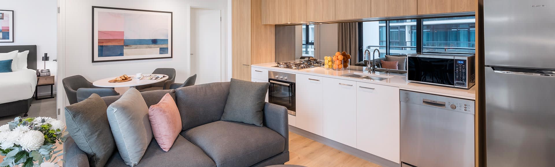 Living room and fully equipped kitchen at Avani Adelaide