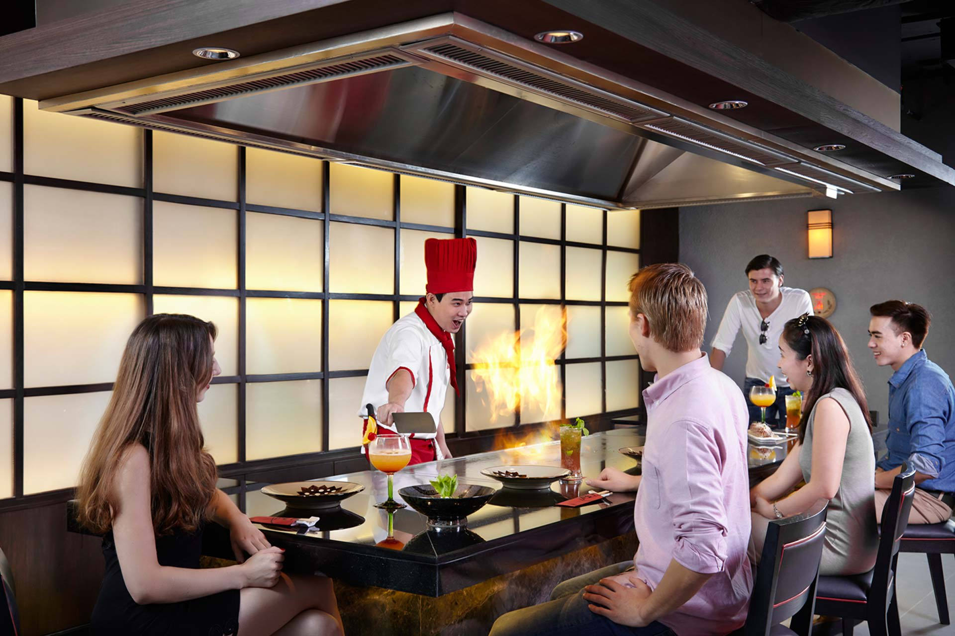 A chef cooking food at Benihana restaurant