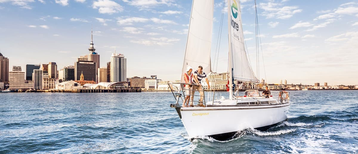 couple on romantic holiday in Auckland sailing near AVANI Metropolis hotel