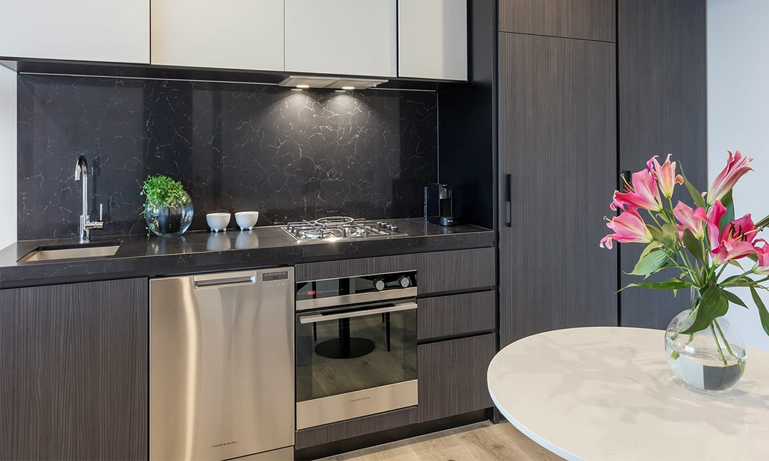 Fully equipped modern kitchen with fridge, cook top, oven, microwave, dishwasher and toaster