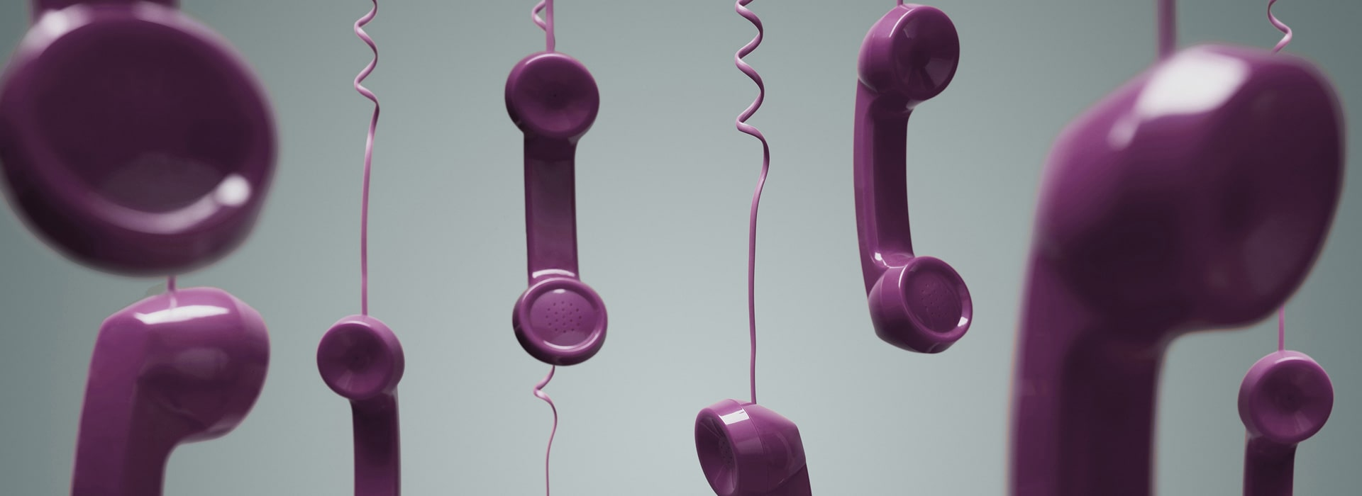 Purple colour hanging telephone handsets