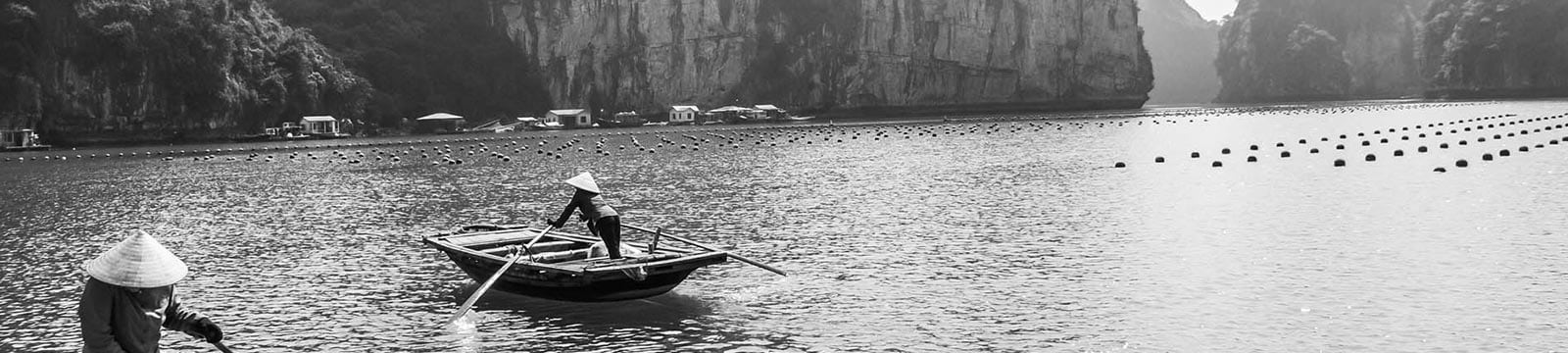 A greyscale image of a traditional fishing set up in Vietnam