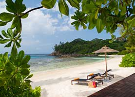 Chaise lounges by the private beach