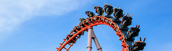 family riding rollercoaster at Movie World on Gold Coast near AVANI Broadbeach hotel