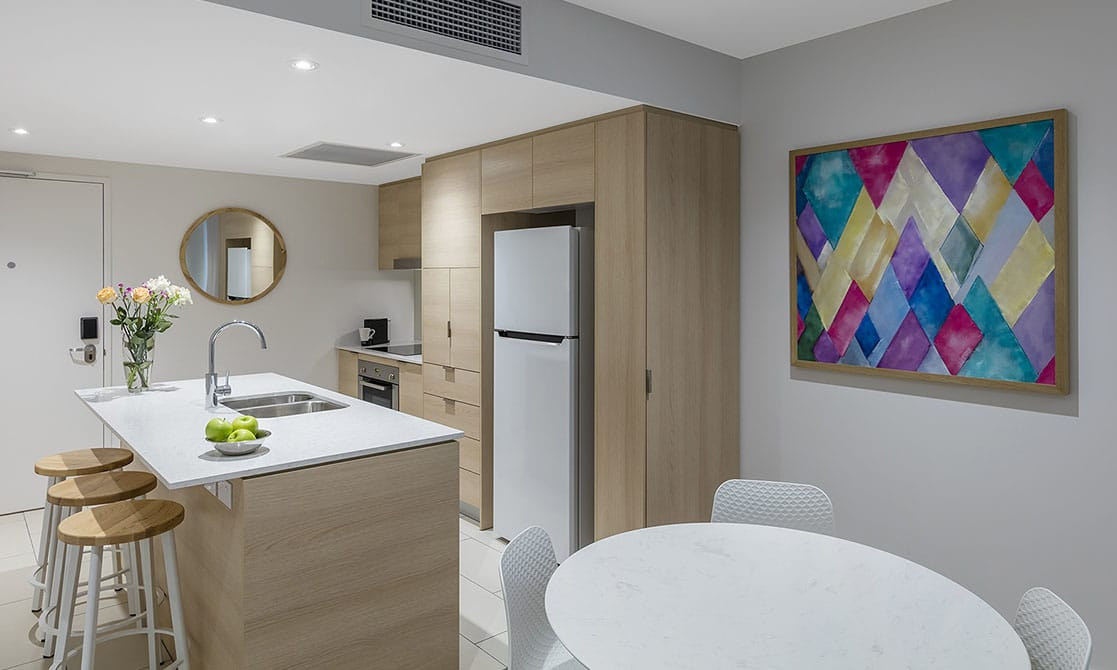 One Bedroom Suite Kitchen and dining area at AVANI Broadbeach Gold Coast Hotels