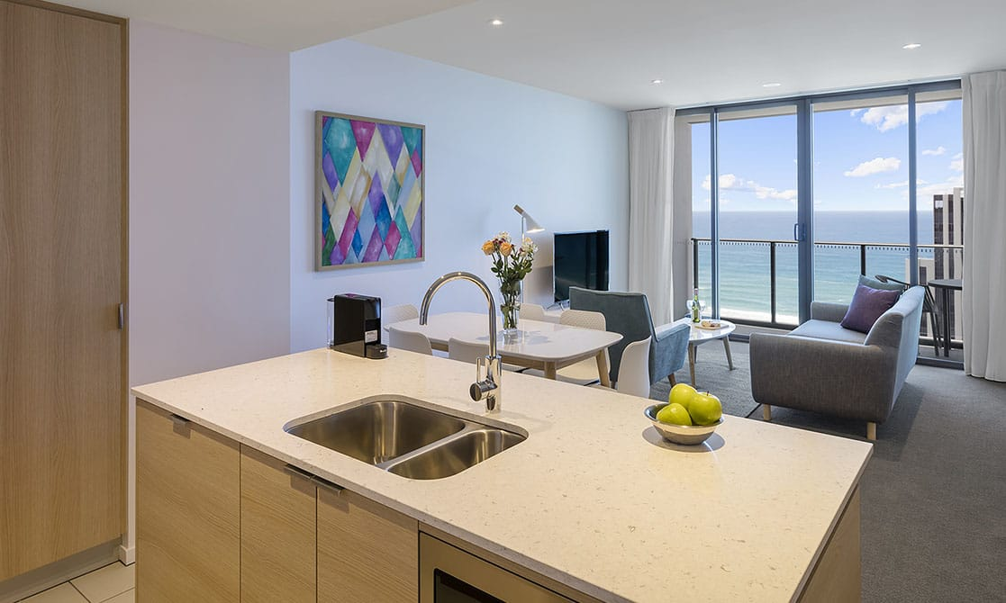 two Bedroom ocean Suite kitchen, dining and living area with grand ocean view at AVANI Broadbeach Gold Coast Hotels