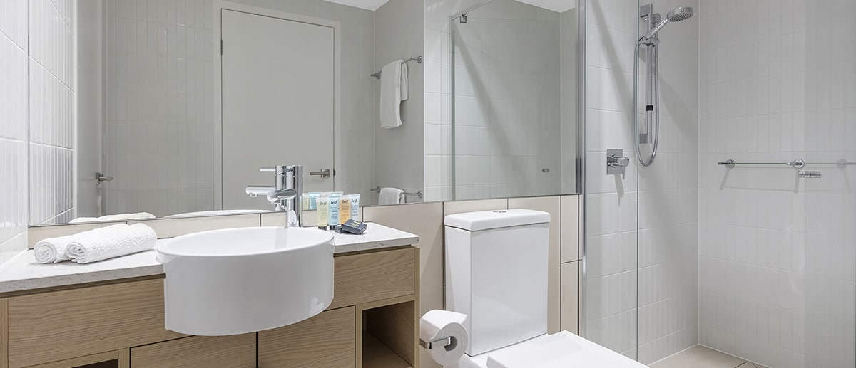 Bathroom with walk-in shower at one bedroom ocean suite AVANI Broadbeach Gold Coast Hotels