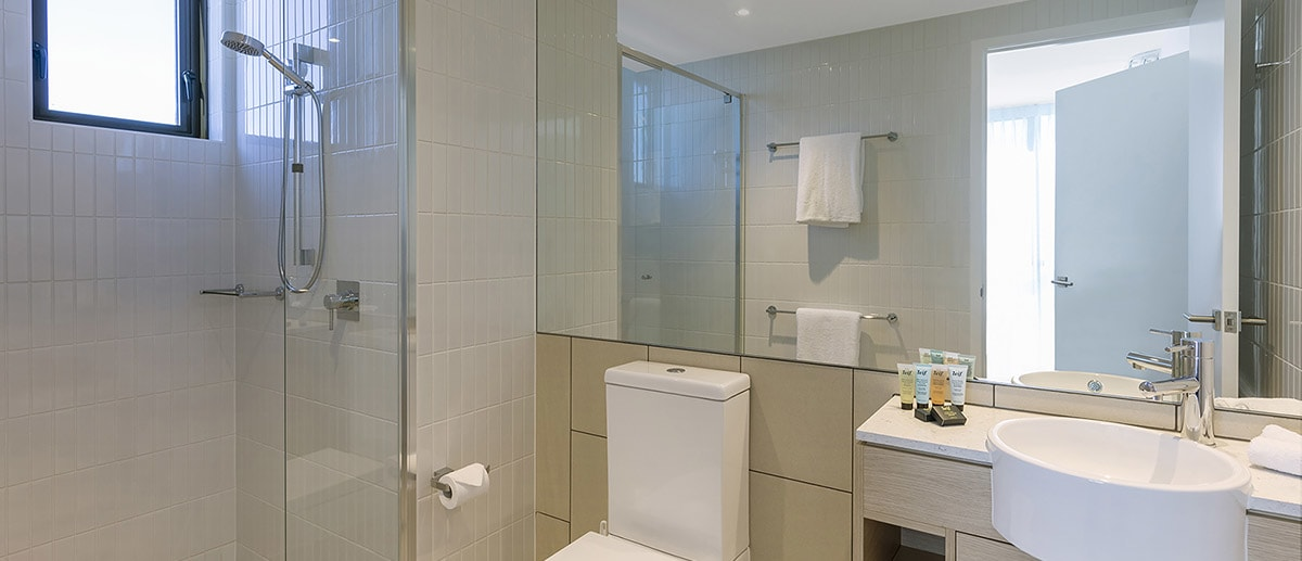 clean and modern bathroom with walk-in shower and the branded toiletries at the one bedroom premier ocean suite AVANI Broadbeach Gold Coast Hotels