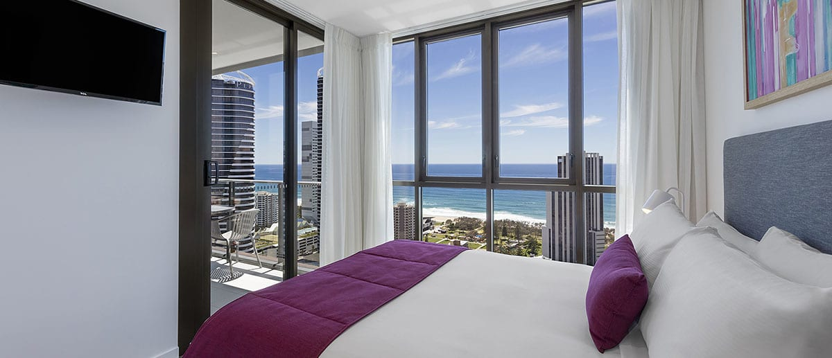 Ocean view in the queen sized bedroom at the one bedroom premier ocean suite AVANI Broadbeach Gold Coast Hotels