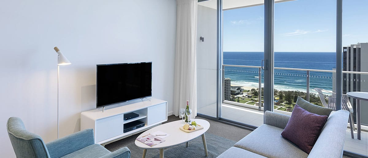 Spacious and comfy living area with grand ocean view at the one bedroom premier ocean suite AVANI Broadbeach Gold Coast Hotels