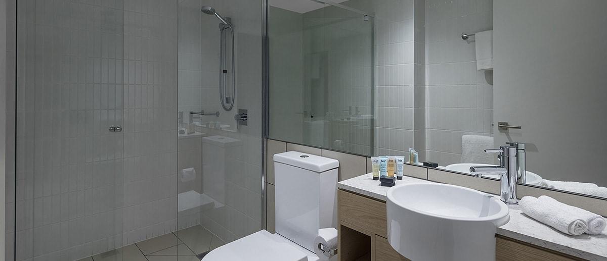 Bathroom with walk-in shower at one bedroom suite AVANI Broadbeach Gold Coast Hotels