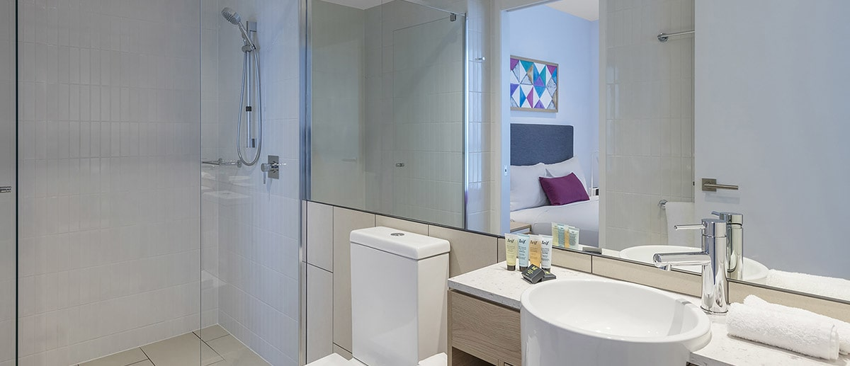 Bathroom with walk-in shower at two bedroom ocean suite AVANI Broadbeach Gold Coast Hotels