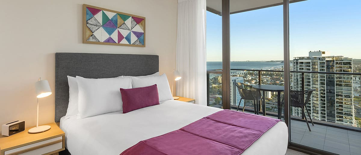Ocean view in the queen sized bedroom with a private balcony at the two bedroom ocean suite AVANI Broadbeach Gold Coast Hotels