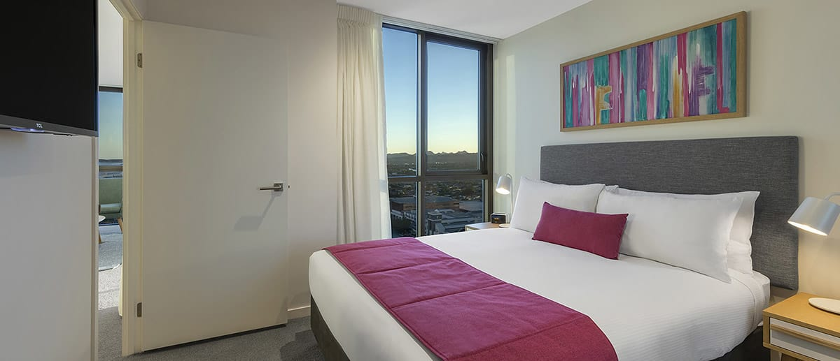 city view in the queen sized bedroom at the two bedroom ocean suite AVANI Broadbeach Gold Coast Hotels