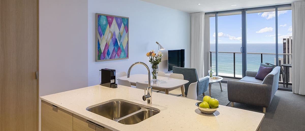 Spacious kitchen, dining and living area with grand ocean view at the two bedroom ocean suite AVANI Broadbeach Gold Coast Hotels