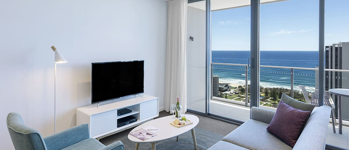 comfortable and spacious living room with grand ocean view at two bedroom ocean suite AVANI Broadbeach Gold Coast Hotels