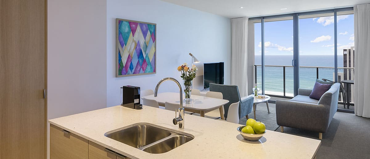 kitchen, dining and living area with grand ocean view at the two premier bedroom ocean suite AVANI Broadbeach Gold Coast Hotels
