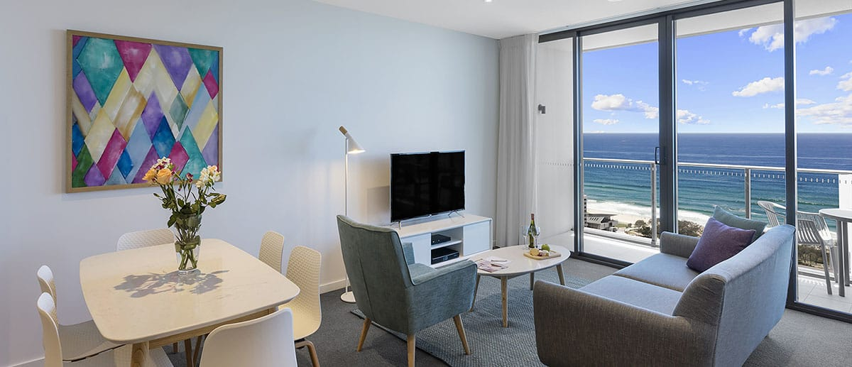 separate dining area and living area with grand ocean view at the two premier bedroom ocean suite AVANI Broadbeach Gold Coast Hotels