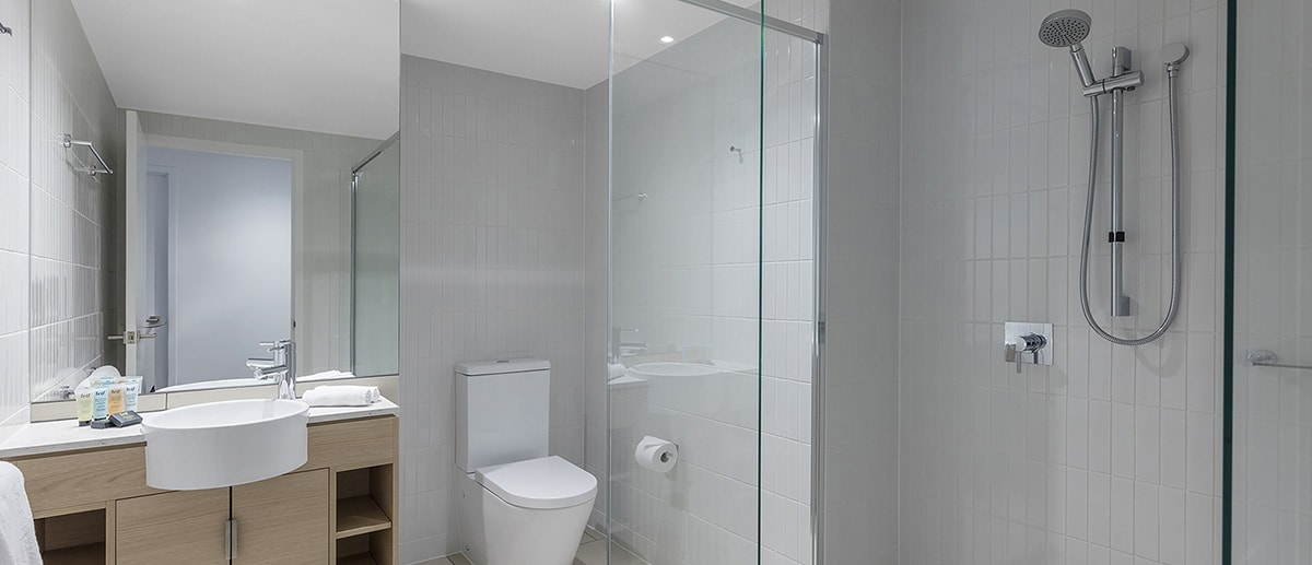 clean and spacious bathroom with walk-in shower and branded toiletries at the two bedroom suite AVANI Broadbeach Gold Coast Hotels