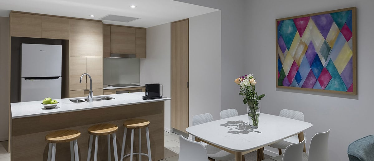 Spacious and separate kitchen and dining areas at the two bedroom suite AVANI Broadbeach Gold Coast Hotels