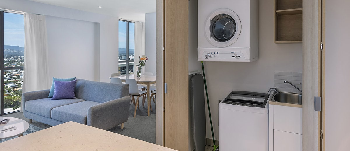Spacious living areas with washing machine, clothes dryer and iron board in the closet at the two bedroom suite AVANI Broadbeach Gold Coast Hotels