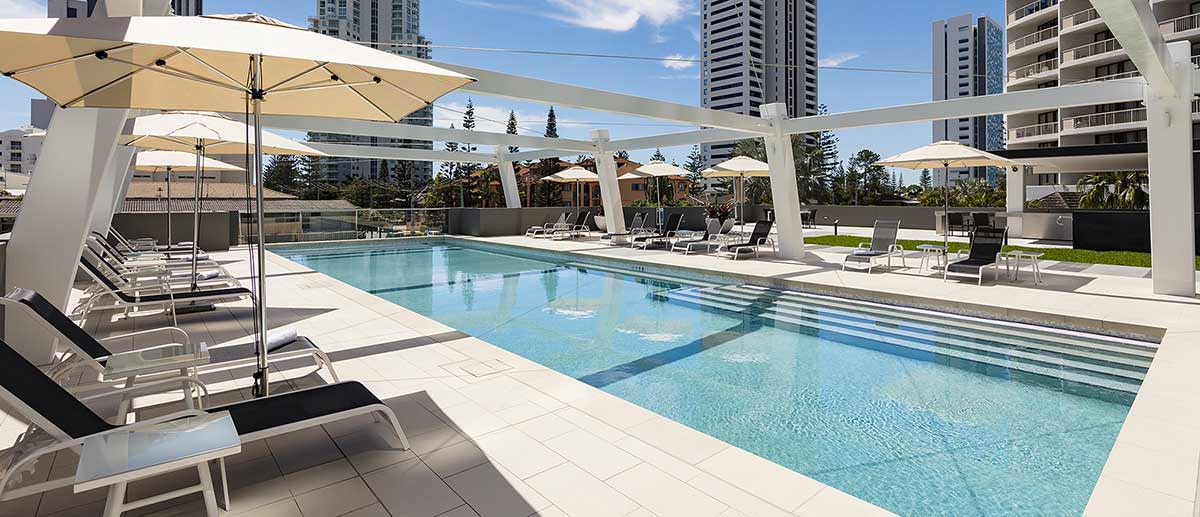 beach chairs by the outdoor pool at AVANI Broadbeach Gold Coast Hotels