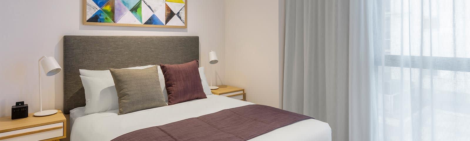 two bedroom suite bedroom at Avani Broadbeach Gold Coast Queensland
