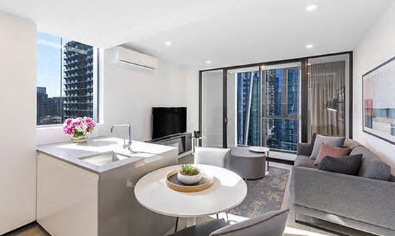 Big living room with air conditioning in central Melbourne hotel 1 Bedroom Apartment