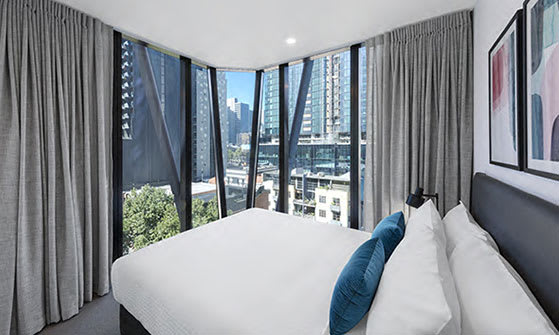 Queen size bed in 2 Bedroom hotel apartment with best views of Melbourne City