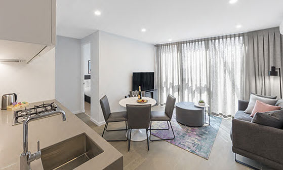 Spacious lounge with Foxtel on TV free Wi-Fi and aircon in 2 Bedroom hotel apartment in Melbourne