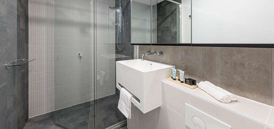 AVANI Central Melbourne hotel bathroom with toilet shower and clean towels