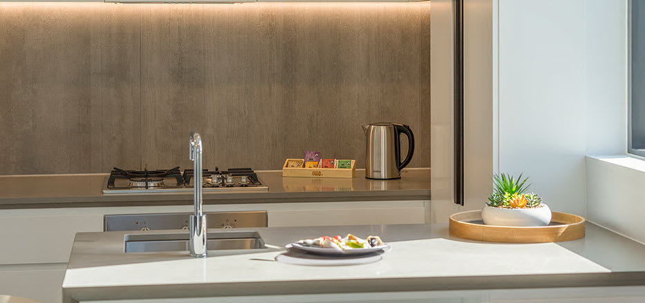 Fully equipped kitchen with kettle and fan forced oven in AVANI Central Melbourne hotel rooms