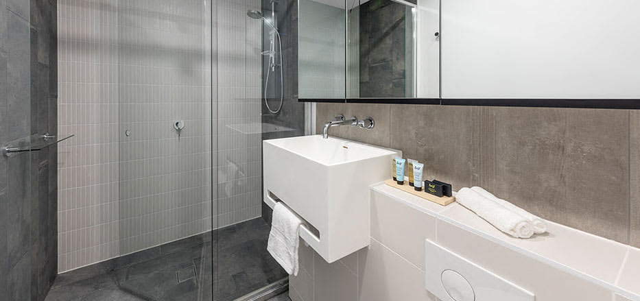Big bathroom in AVANI Central Melbourne hotel apartment with large shower