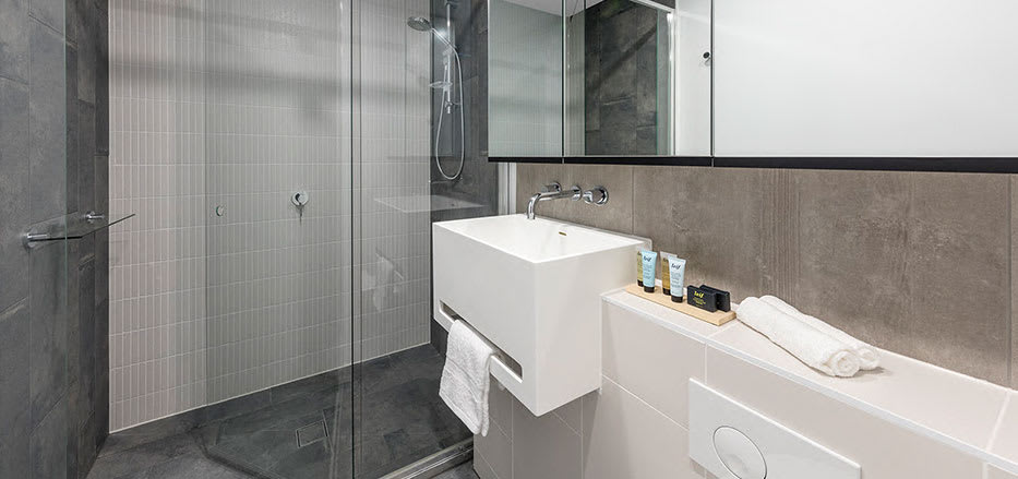Disabled access shower in 2 bedroom apartment of AVANI Central Melbourne hotel