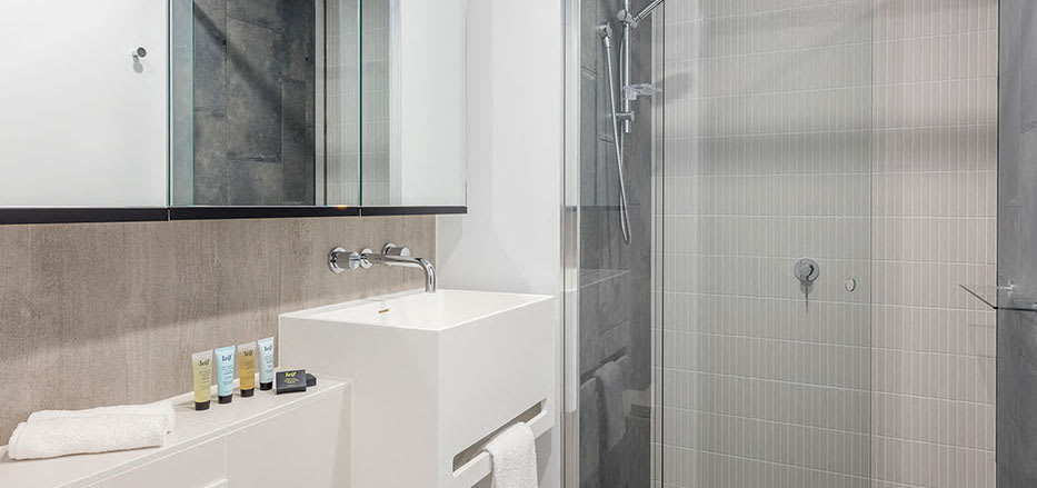 Large mirrors in bathroom of 2 bedroom apartment in AVANI Central Melbourne hotel