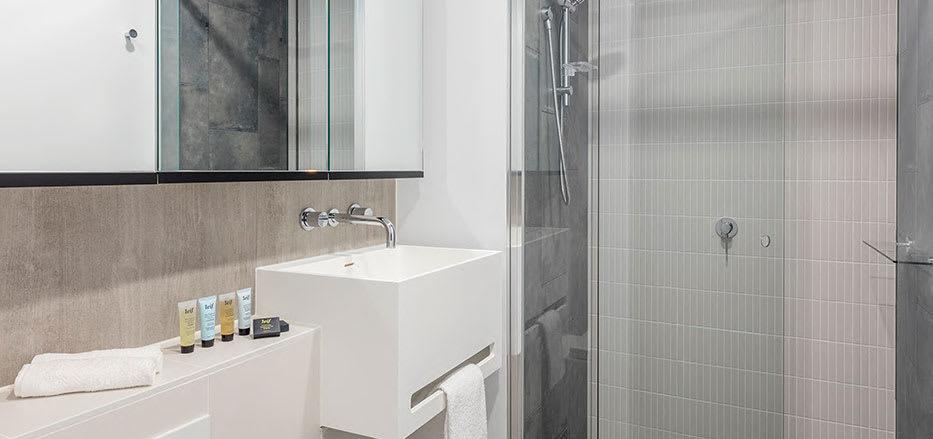 Big shower inside AVANI Central Melbourne hotel apartments