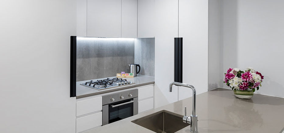 Big kitchen with lots of storage space in modern 2 Bedroom Hotel Apartment in Central Melbourne