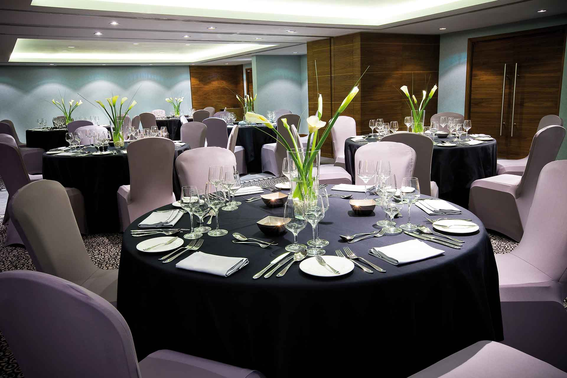 Banquet hall with a round table setup at AVANI Deira Dubai