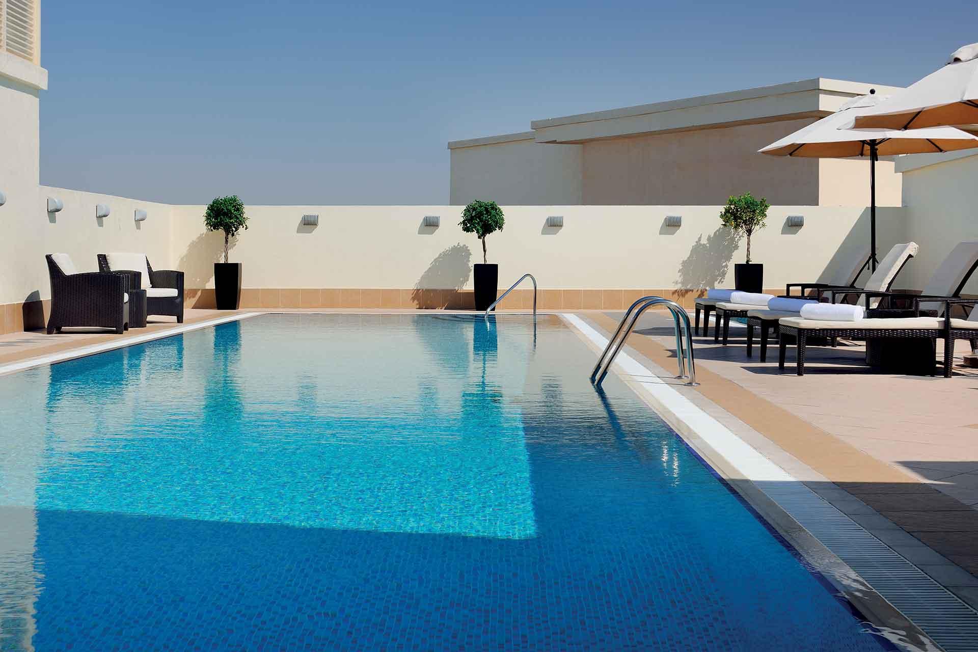 AVANI Deira Dubai rooftop pool area