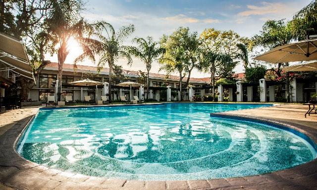 The pool deck of AVANI Garborone