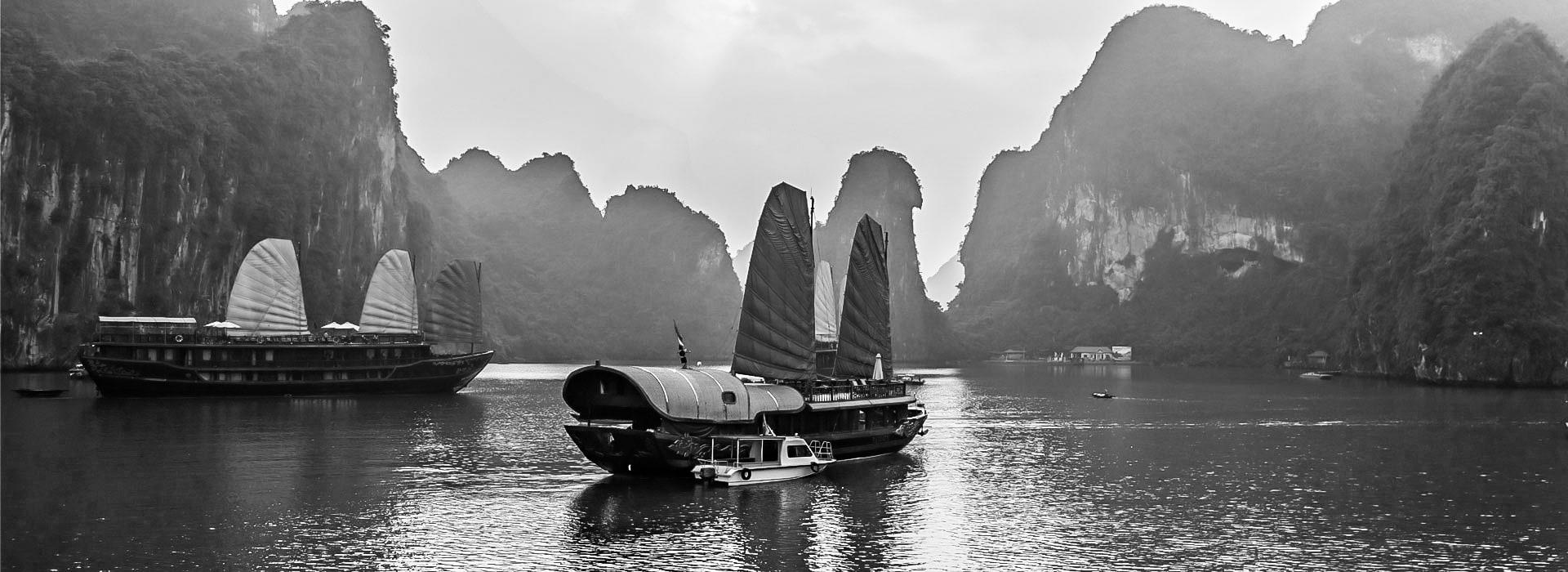 Traditional boats sailing at Hai Phong Harbour