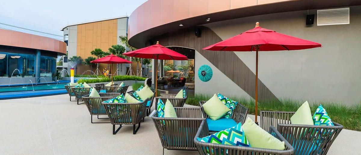 Outdoor seating at AQUA pool bar