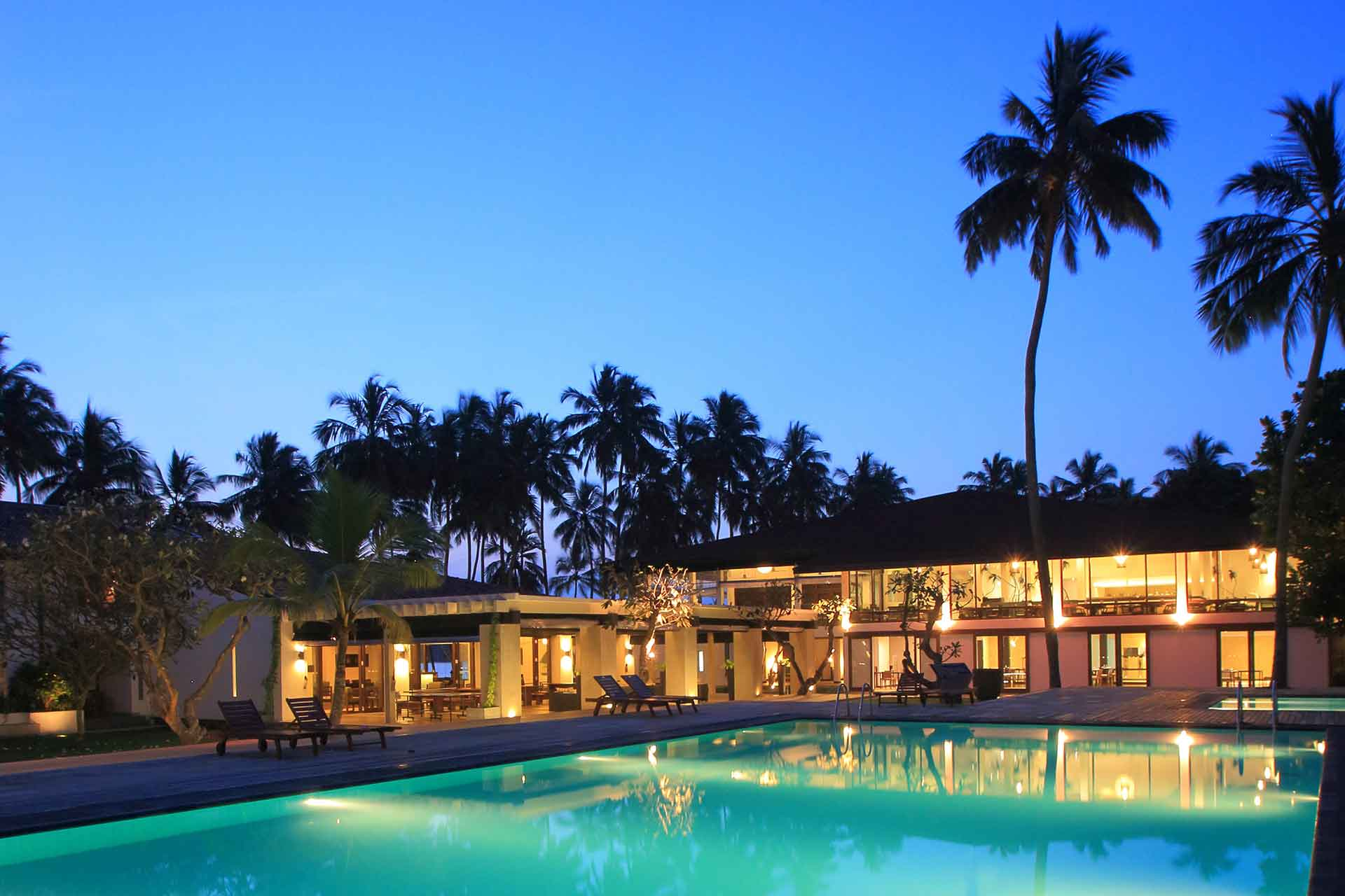 View of the AVANI Kalutara Resort pool at night