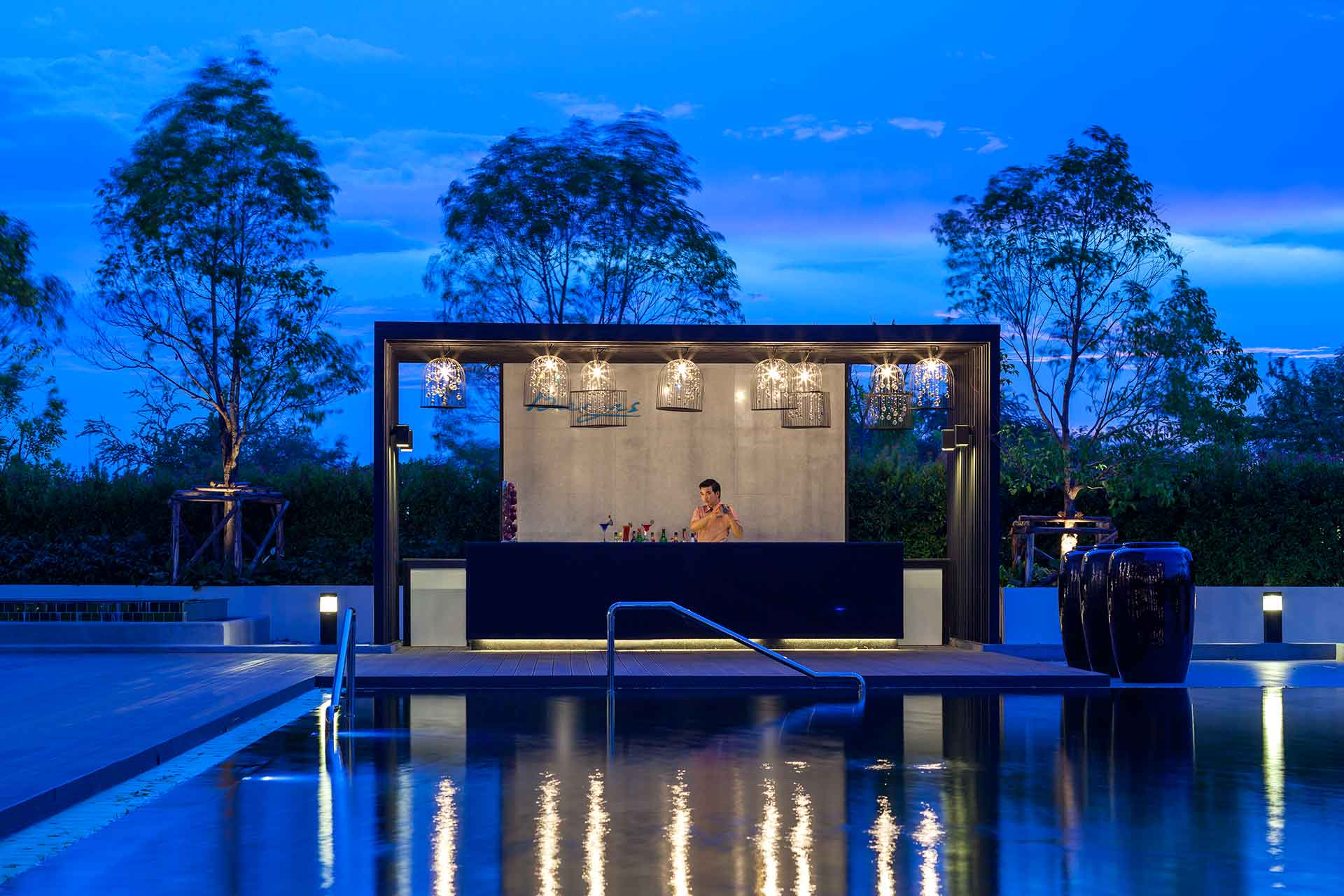 The breeze bar by pool at dusk