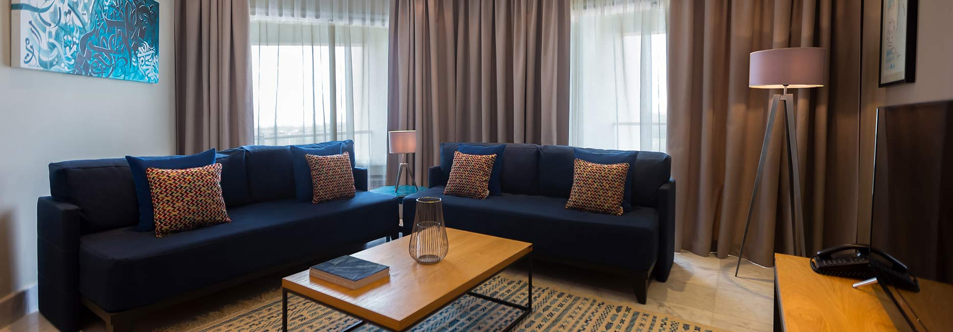 Avani One Bedroom Suite Living Room at Avani Les Berges du Lac Tunis Suites