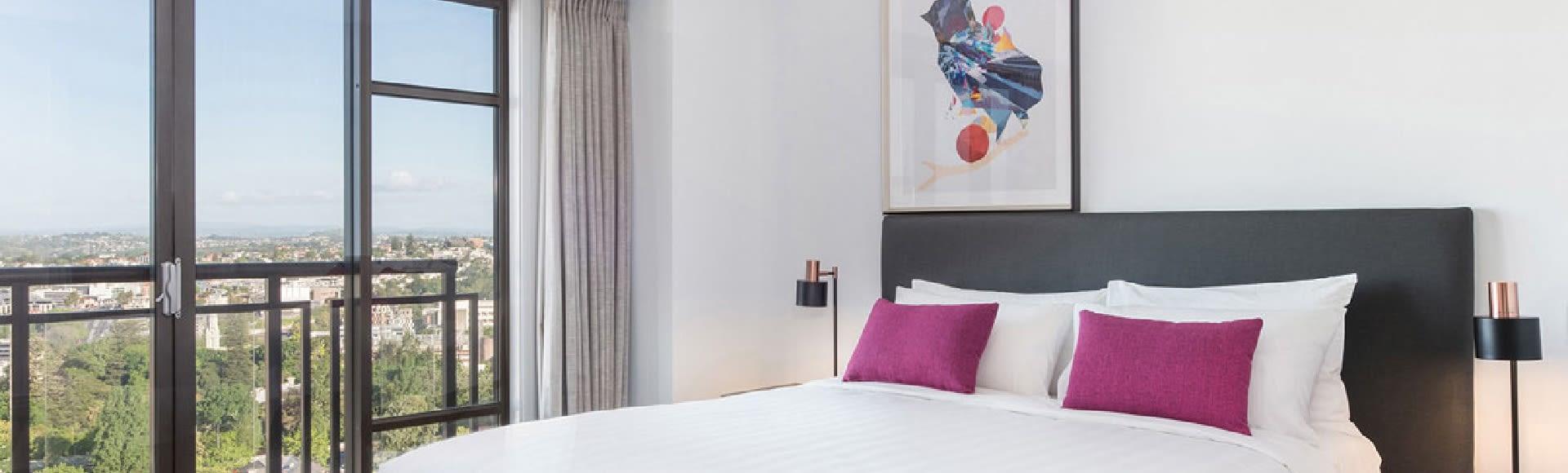AVANI Metropolis 2 Bedroom Suite Bedroom with City Views