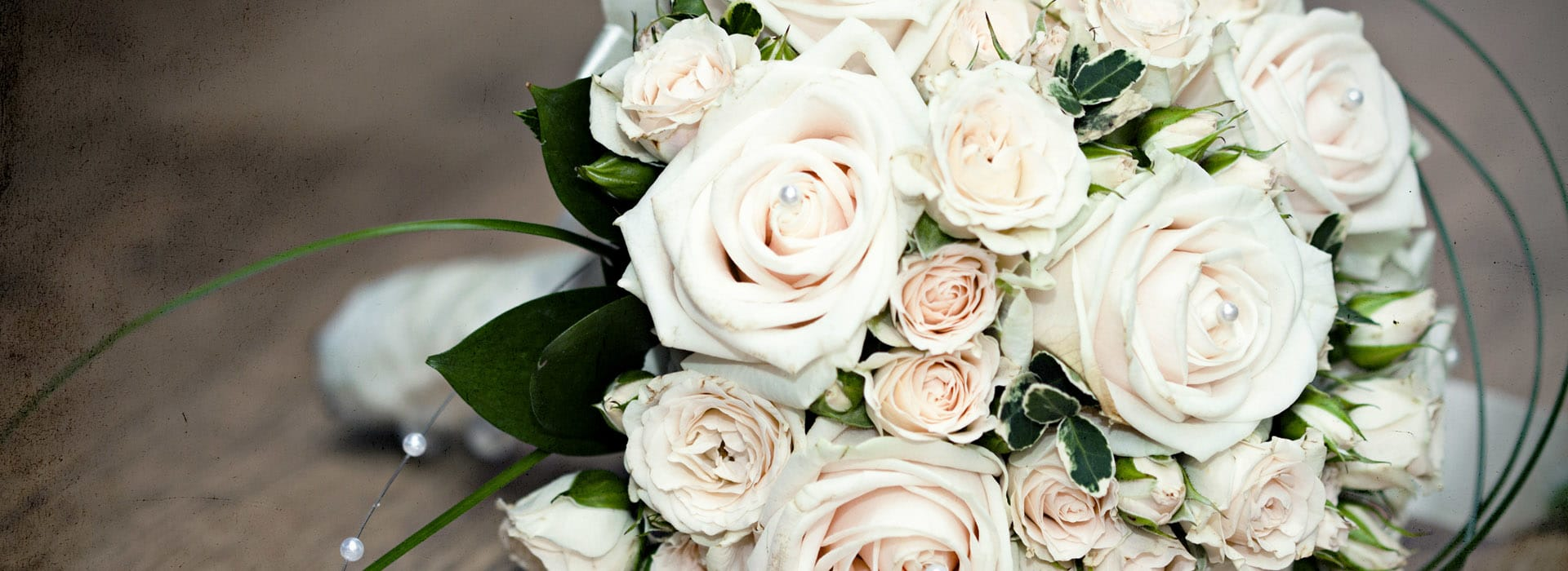A wedding bouquet of whites roses
