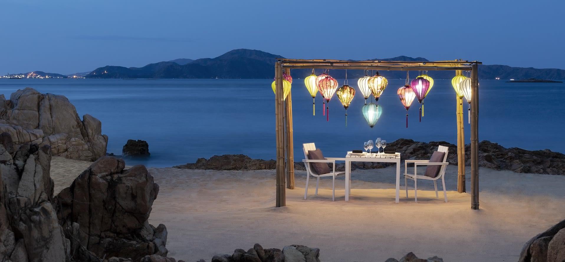 Avani Quy Nhon romantic private dining setting on the beach